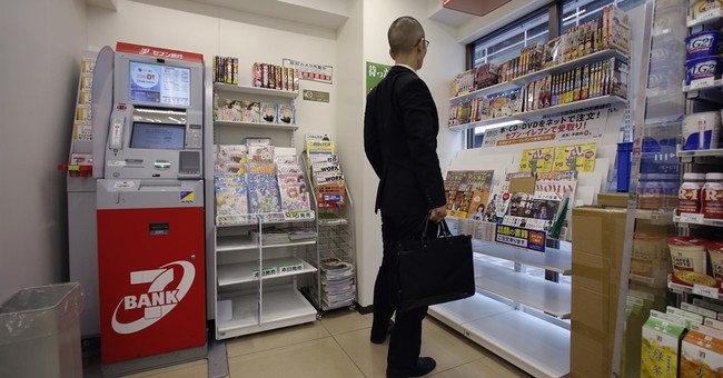 Japanese banks raise guard after $16 million taken from ATMs