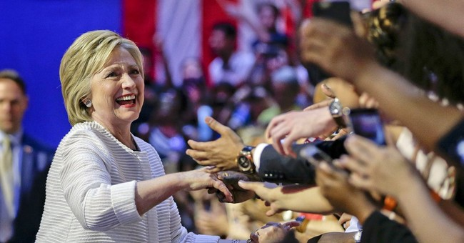 AP Interview: Clinton says Trump behaving like a demagogue