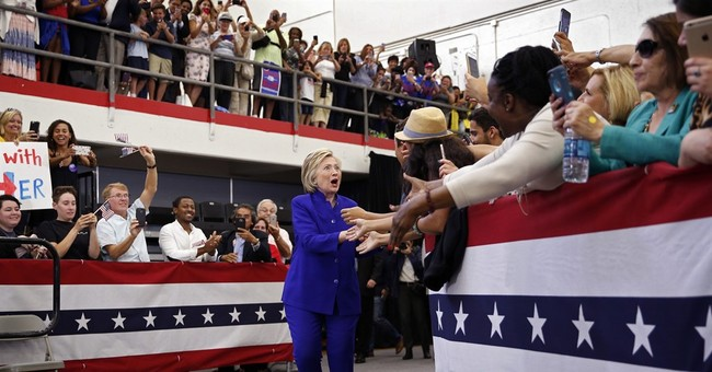 The Latest: Clinton basks in celebrity glow at LA fundraiser