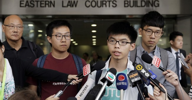 Hong Kong teen activist acquitted over 2014 China protest