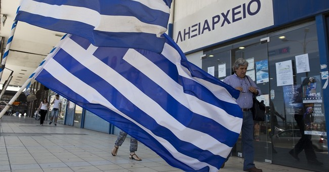 Greece says last obstacles lifted for rescue loan payout