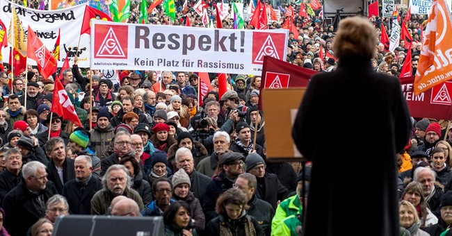 Thousands in Germany protest racism, attacks on refugees
