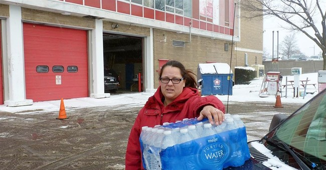 The Latest: Michael Moore returns to Flint amid water crisis