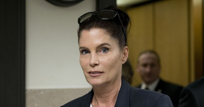 Top prosecutor's twin files complaint about sister's office