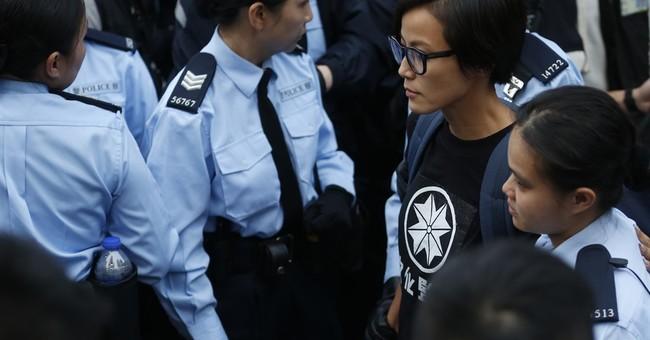 Lancome shuts Hong Kong shops as 'kowtow' controversy grows