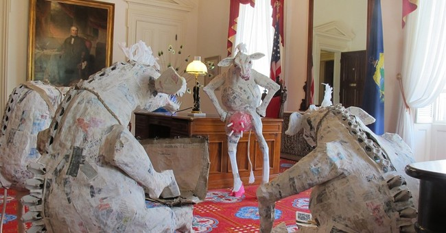 Governor's artist-wife's humorous work on Statehouse display