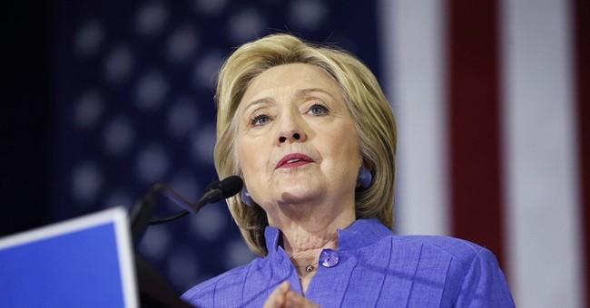 AP Interview: Clinton says Trump behaving like a demagogue