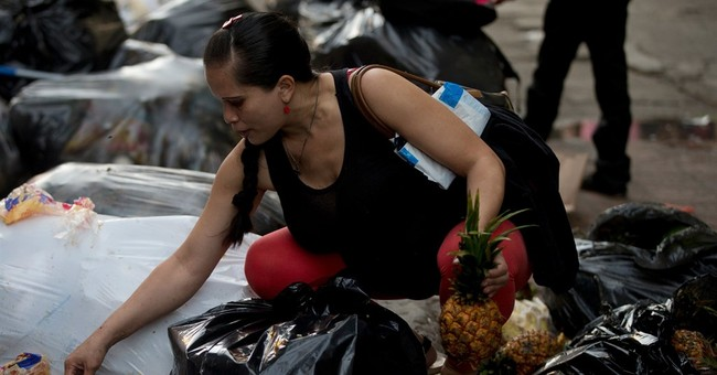 Venezuelans pick through trash for food to eat or sell