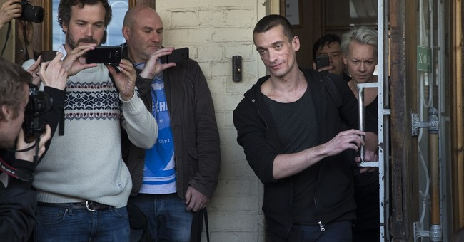 Russian courts convicts, releases dissident artist
