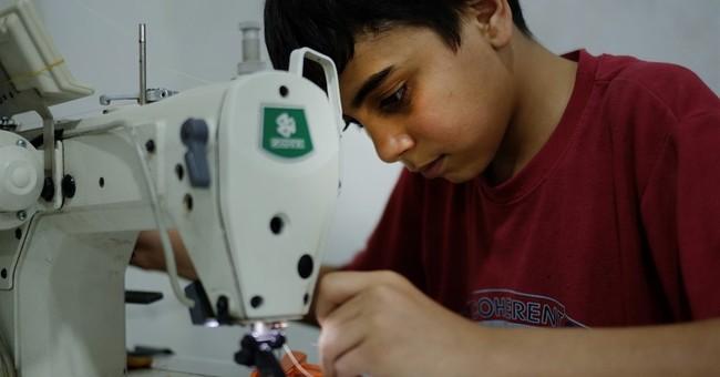 AP PHOTOS: Refugee children labor in Turkish factories