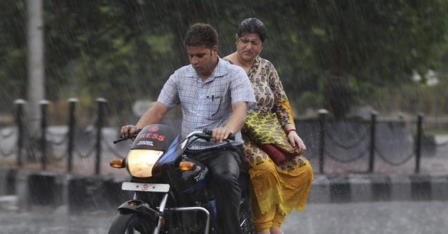 Image of Asia: Driving through the rain in India