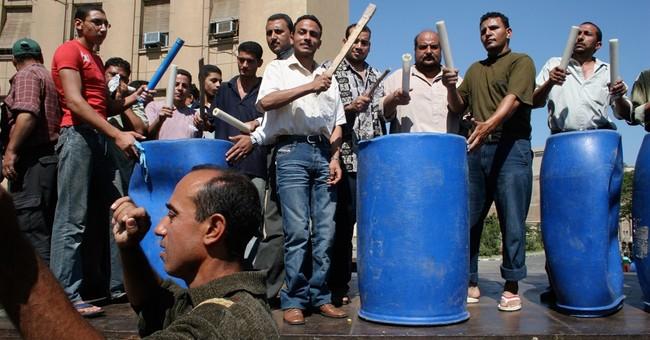 Hard times in Egypt stoke labor unrest, showdown ahead