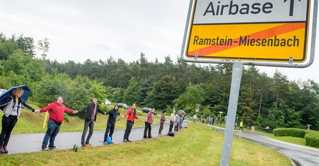 Demonstrators form human chain near US base in Germany