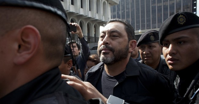 Guatemala arrests 2 ex-cabinet ministers, hunts for 3 more
