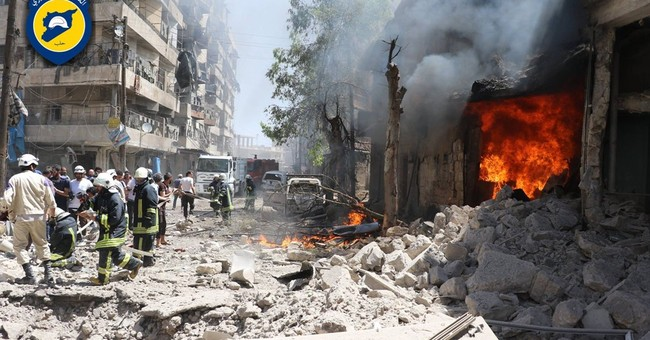 In Syria's Aleppo, divided locals share fear of total siege