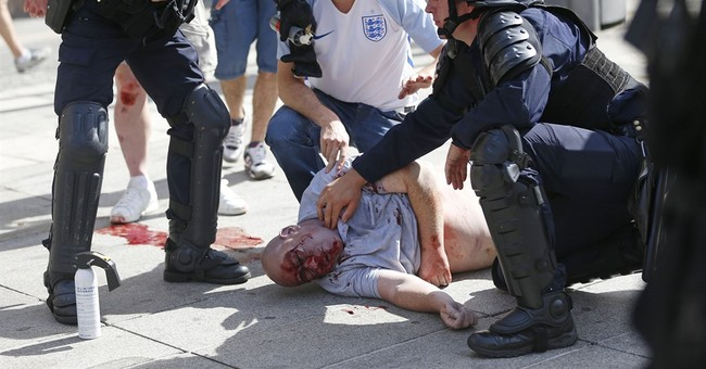 Hooliganism scars Euro 2016 as England, Russia risk ejection