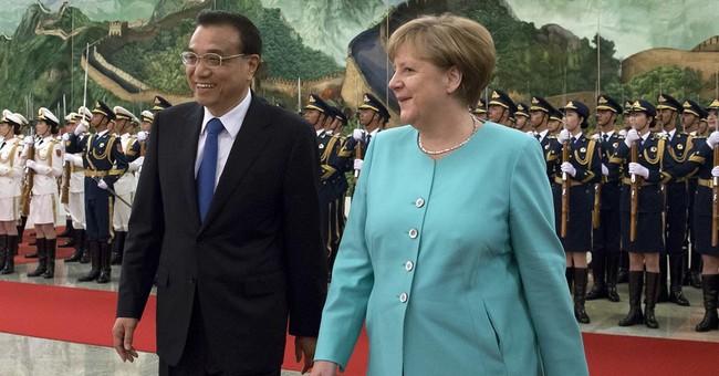 Germany's Merkel meets Chinese premier amid trade worries