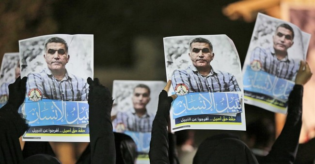 Bahrain detains prominent activist during raid on his home