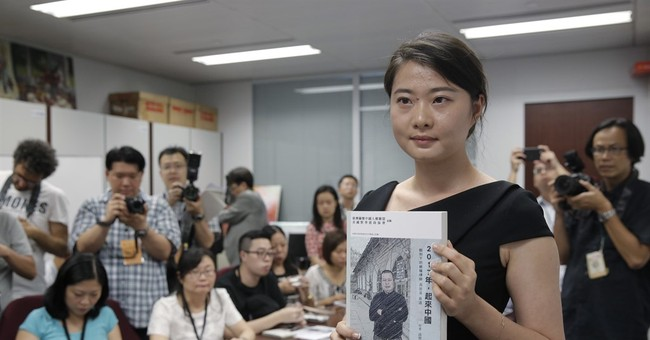 AP Interview: Chinese lawyer not giving up despite torture