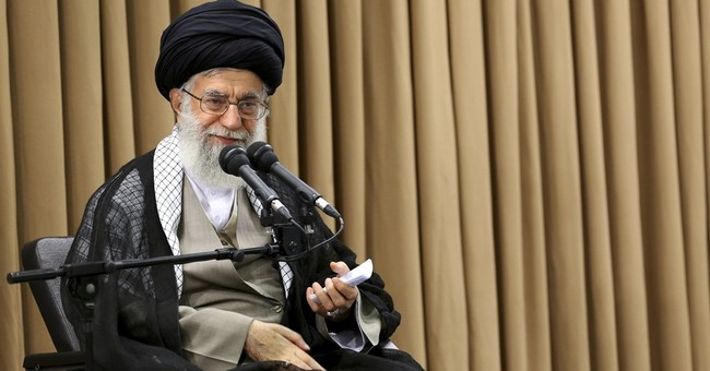 Iran vows to burn nuclear agreement if US scraps it