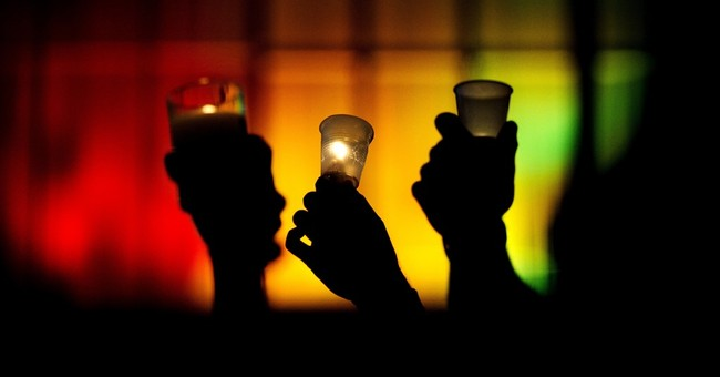 AP PHOTOS: World honors club victims with candles, prayers