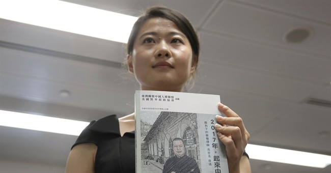 Q&A: Tortured Chinese lawyer on his faith, hopes _ and teeth