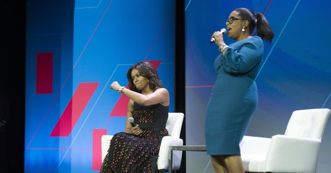 Michelle Obama urges men at women's summit to 'be better'