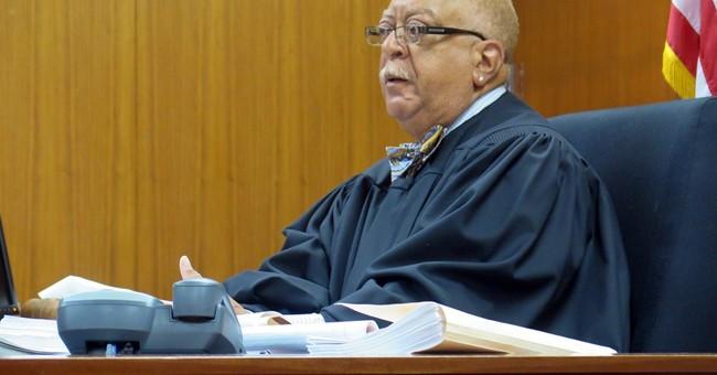 Michigan judge tosses misconduct counts against ex-lawmakers