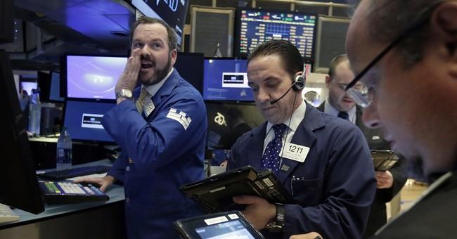 Asian markets lower as BOJ stands pat; yen jumps vs dollar