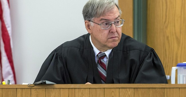 The Latest: Prosecutor dismisses 2 charges against senator