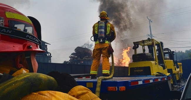The Latest: Some warehouse fire evacuations lifted