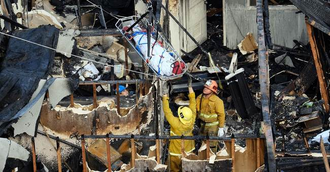 Homeless man charged in fire deaths was in US illegally