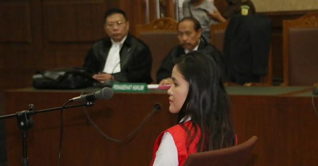 Indonesian lawyers deny woman killed friend with cyanide