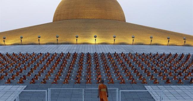 Dead tigers, stashed wealth cast spotlight on Thai monks
