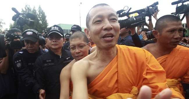 Police fail to arrest popular Thai monk after tense showdown