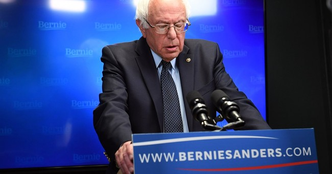 Sanders, yet to concede, says he'll work for Trump's defeat