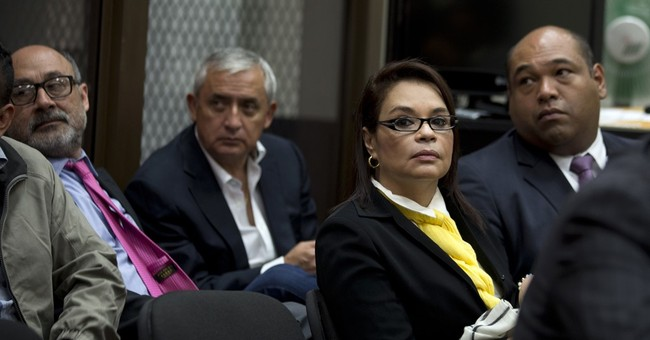 Ex-Guatemalan president and VP charged in corruption scheme