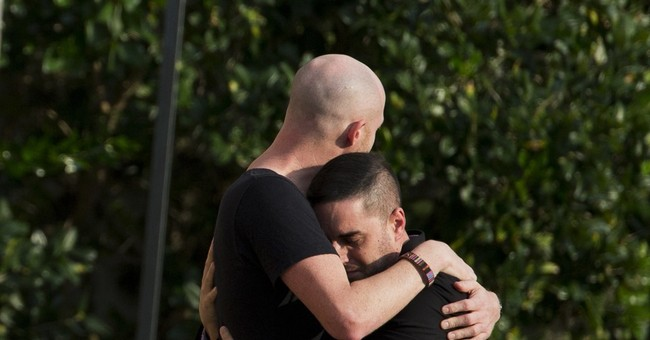 The Latest: Gunman tried to buy body armor before attack
