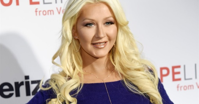 Aguilera pens song to benefit shooting victims' families