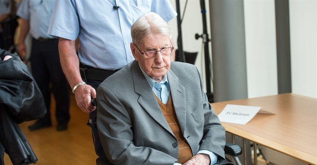 Court convicts Auschwitz guard, 94, as accessory to murder