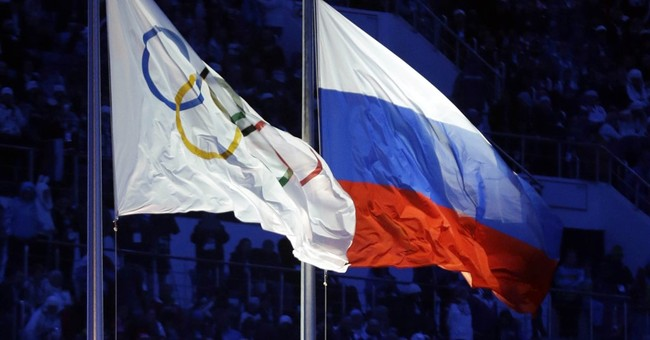 The Latest: Putin hopes for 'solution' for Russian athletes