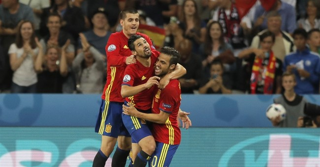 The Latest: Turkey fans light flares after loss to Spain
