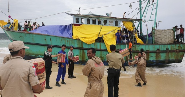 Indonesian province prepares to tow migrant boat out to sea