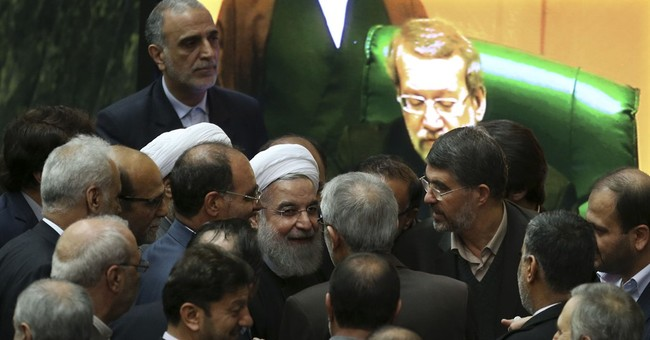 Iran welcomes sanctions' end, but tough thaw ahead