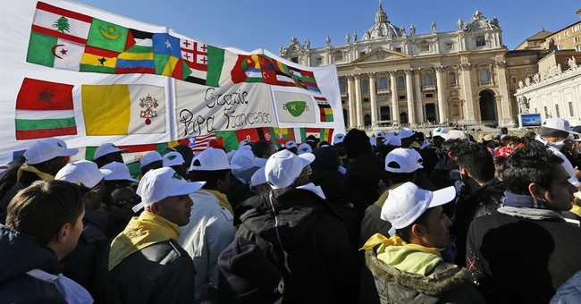 Pope to migrants at the Vatican: Hang on to hope, joy