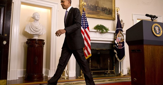 Obama celebrates return of prisoners, announces sanctions
