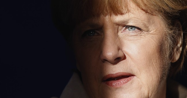 Merkel's migrant troubles flare but chancellor stands firm