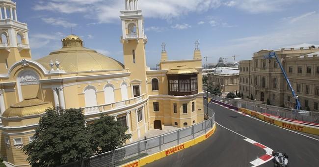 Rosberg takes pole in Baku as Hamilton crashes out