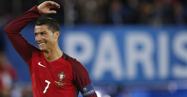 Unhappy Ronaldo throws reporter's microphone away