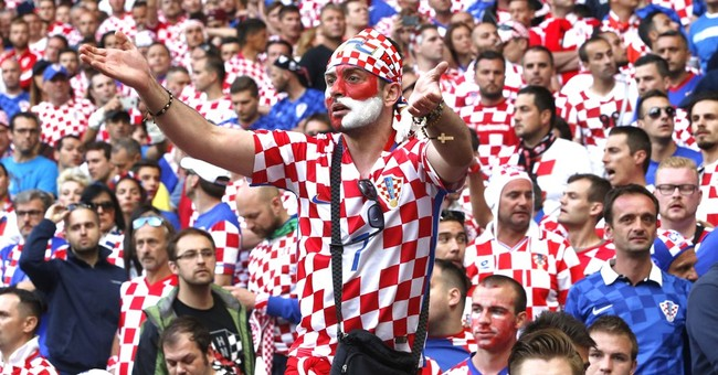 UEFA charges Croatia soccer body for fan disorder, racism